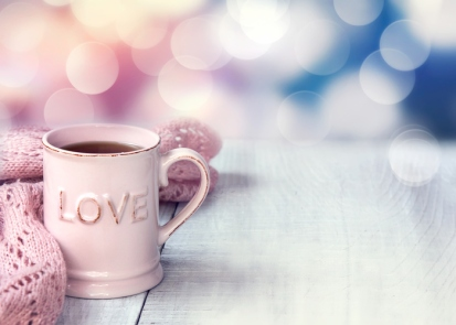 Mug  on wooden table valentine's day holiday background.
