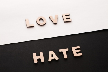 Words Love and Hate on contrast background
